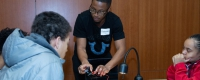 DeKwuan Stokes, a graduate student in the Swanson School of Engineering, mentoring high school students